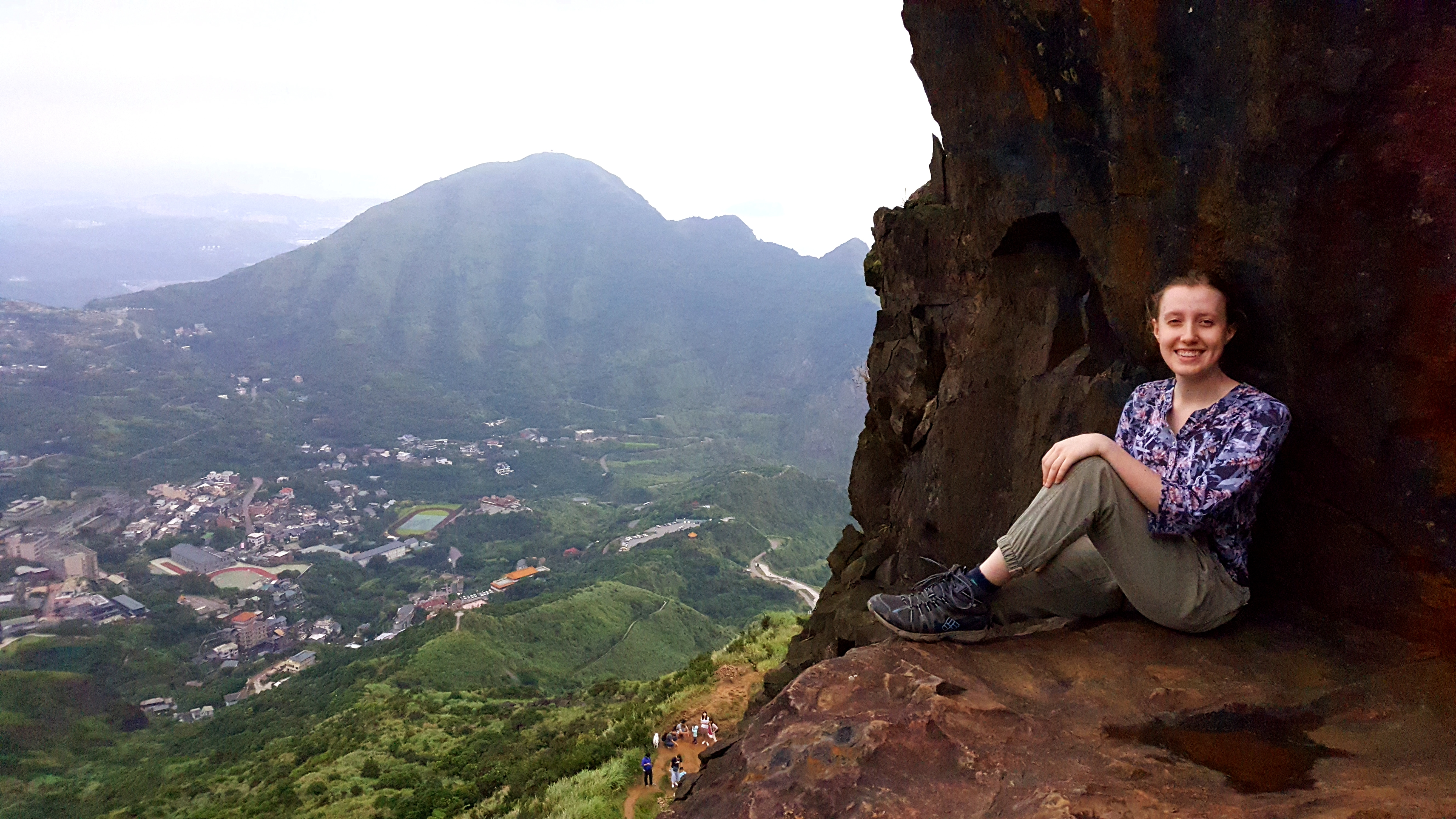 Enjoying the view after hiking Teapot Mountain (無耳茶壺山) in northern Taiwan.