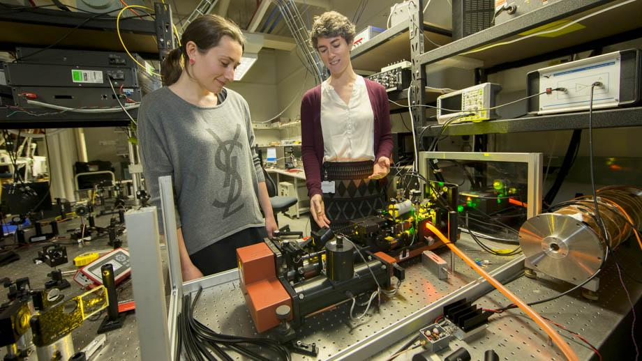 Dr Rose Ahlefeldt (right) in her lab at the ANU Research School of Physics and Engineering. Photo by Lannon Harley.