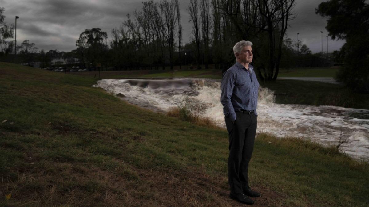 Mark Howden standing beside a creek