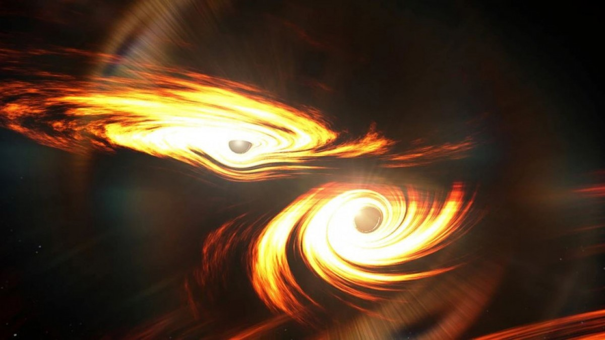 Artist impression of two black holes colliding in space.