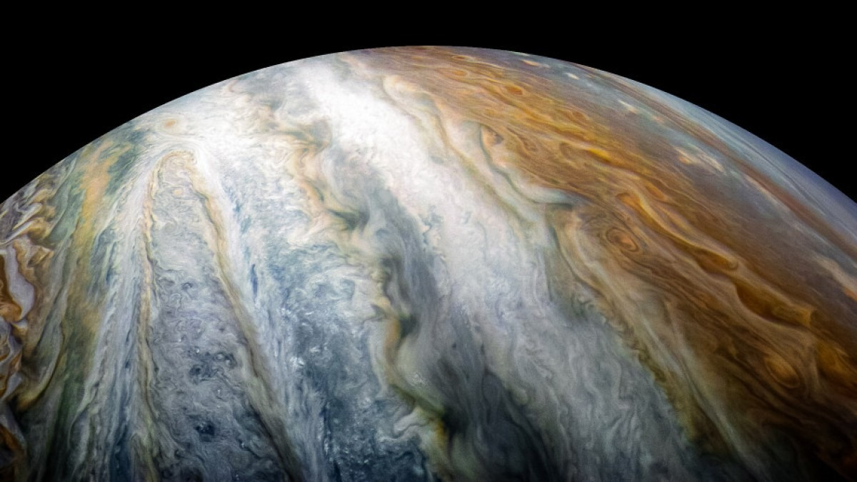 Jupiter showing colourful cloud swirls.