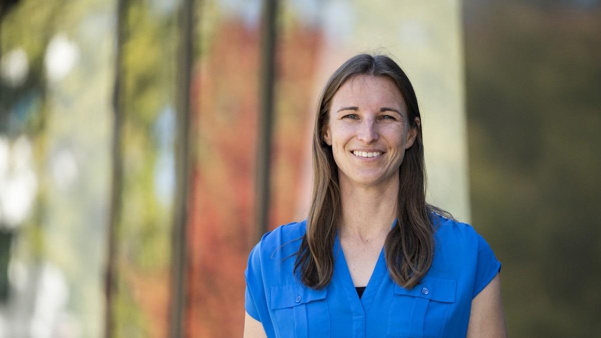 Dr Lara Malins outside