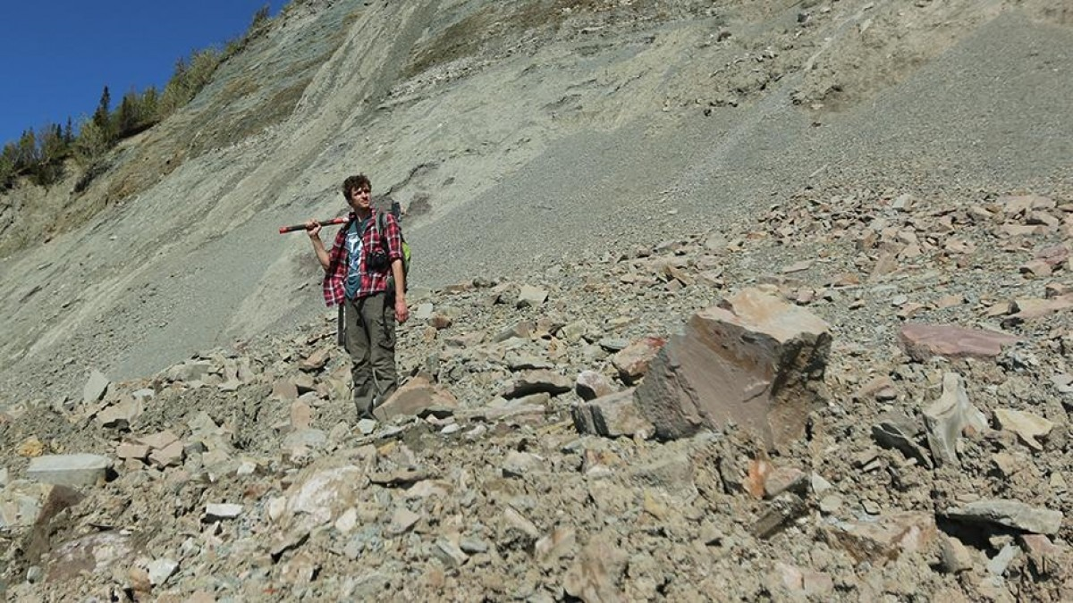 ANU researcher Ilya Bobrovskiy searches for fossils in the Zimnie Gory locality, Russia