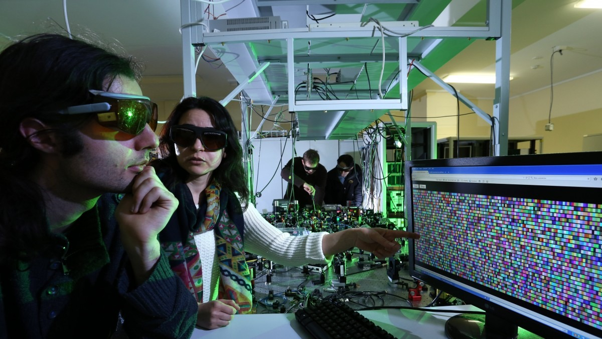 Scientists working in quantum optics lab.