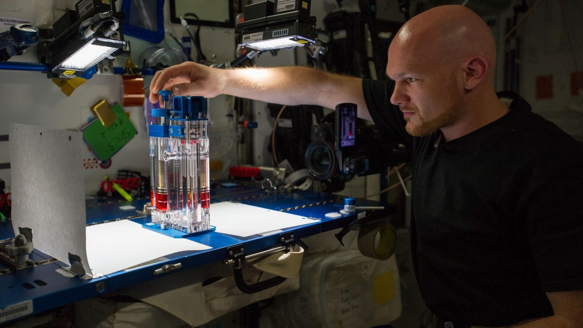 ESA astronaut Alexander Gerst conducts a capillary flow experiment in space