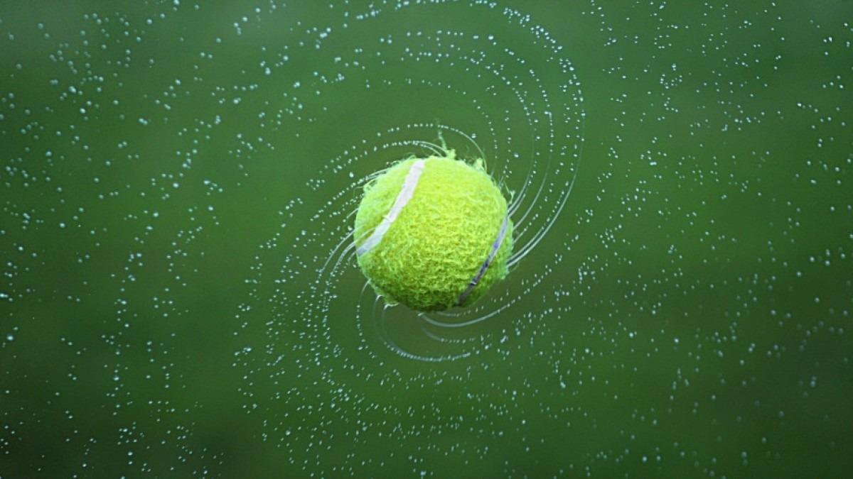 Tennis ball, spinning in air.